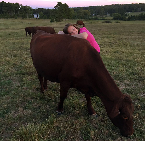 DeAnne and a Red Devon Cow